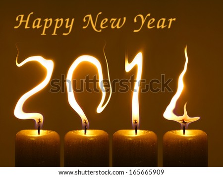 Happy new year 2014, flames of candles write numbers 2014 - stock photo