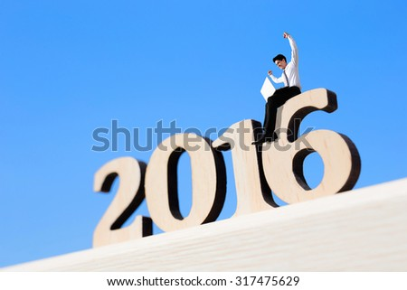 Happy new year for 2016 - success business man with laptop computer and sitting on wood number - stock photo