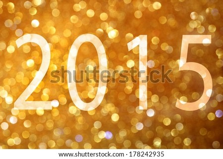 Happy New Year 2015. Gold glittering christmas lights. Blurred abstract background - stock photo