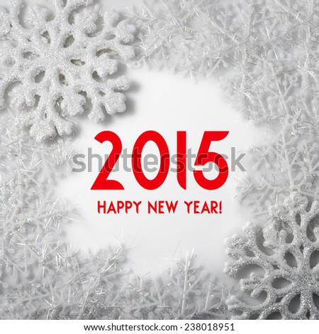 Happy New Year 2015! Greeting card. Christmas decoration.White Snowflakes on a white background. Winter holiday symbol - stock photo