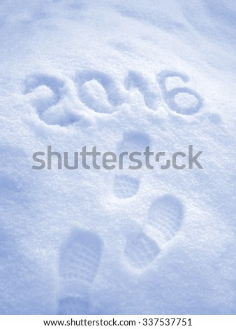 Happy New Year 2016 greeting, foot step prints in snow - stock photo