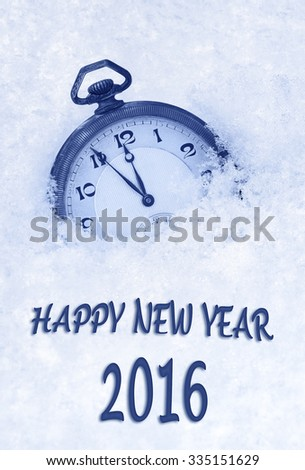 Happy New Year 2016 greeting in English language, pocket watch in snow - stock photo