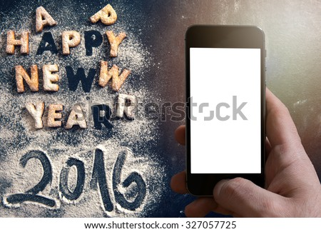 Happy New Year 2016 greeting with cookies letters on dark background with blank space on smart phone - stock photo