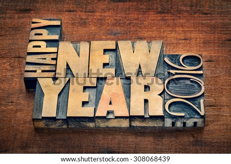 Happy New Year 2016 greetings  - text in grunge letterpress wood type blocks on a rustic wooden background - stock photo