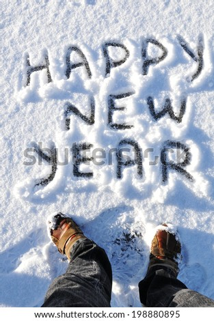 Happy New Year greetings written on snow - stock photo