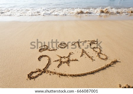 Happy New Year 2018, lettering on the beach