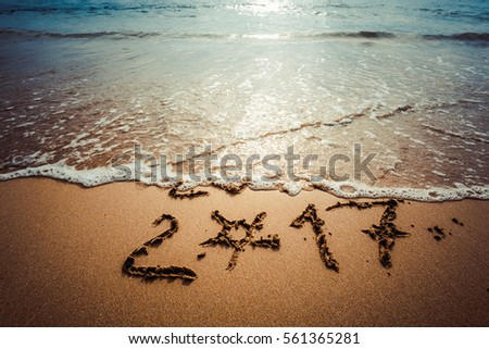 Happy New Year 2017, lettering on the beach. Instagram effect (vintage).