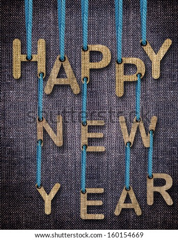 Happy New Year Letters hanging strings with blue sackcloth background. - stock photo