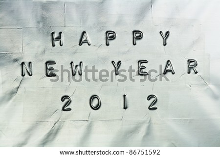 Happy New Year logo on a silver background
