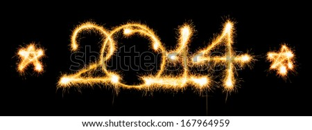 Happy New Year - 2014 made a sparkler on a black background - stock photo