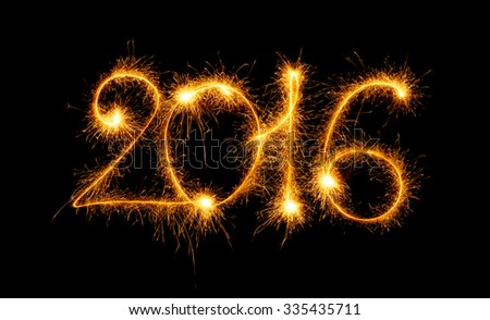 Happy New Year - 2016 made with sparklers on black background - stock photo