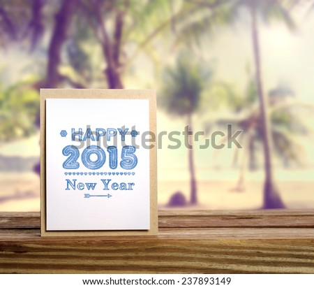 Happy New Year 2015 message card with palm trees - stock photo