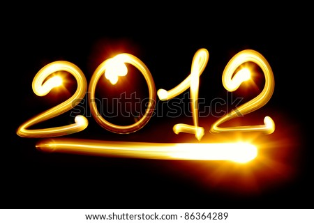 Happy new year 2012 message over black background - stock photo