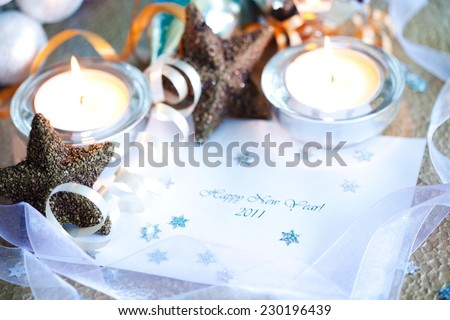 Happy New Year note surrounded by chrismas decoration - stock photo