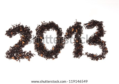Happy New Year 2013. Number written with berry's tea leaves - stock photo