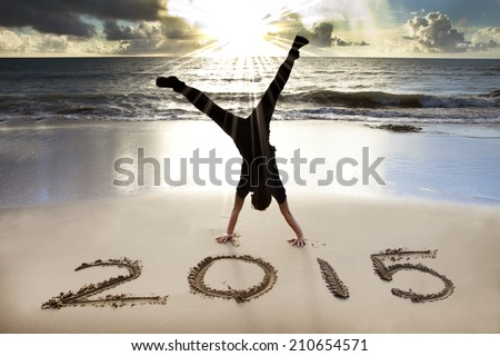 happy new year 2015 on the beach with sunrise - stock photo