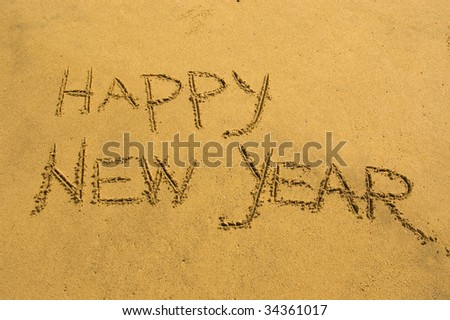Happy new year on the sand - stock photo