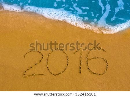 Happy New Year 2016 on the sea beach - stock photo