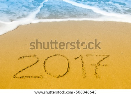 Happy New Year 2017 on the sea beach