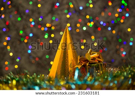 Happy New Year party hat, cone-shaped and gift box - stock photo