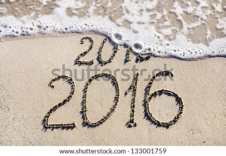 Happy New Year 2016 replace 2015 concept on the sea beach - stock photo
