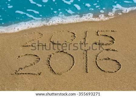 Happy New Year 2016 replace 2015 concept on the sea beach. - stock photo