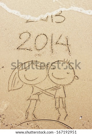 Happy New Year 2014 replace 2013 concept on the sea beach with happy lovers,boy and girl - stock photo