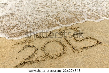 Happy New Year 2015 replace 2014 year concept on the beach - stock photo