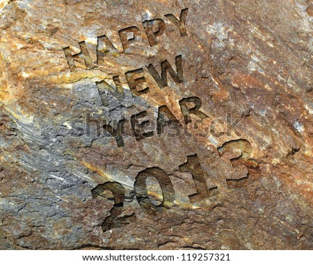 Happy new year 2013 sculpted in ancient stone - stock photo