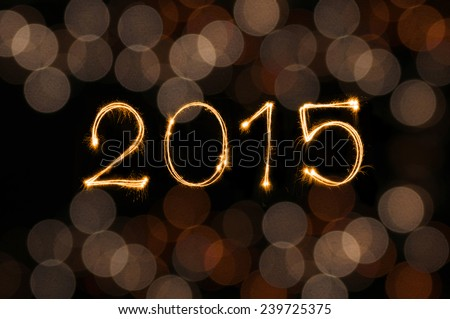 Happy New Year 2015 sparkle firework writing with dirty defocused gold lights blur bokeh background  - stock photo