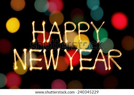 Happy New Year sparkle firework writing with unfocused dirty gold light blur bokeh background - stock photo