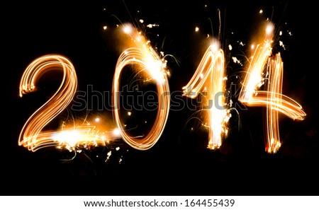 Happy New Year 2014 sparklers firework - stock photo