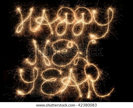 Happy New Year - sparklers in the night - stock photo