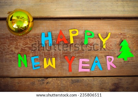 Happy New Year text  on wood background - stock photo