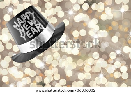 Happy new year top hat with a festive glitter background. - stock photo