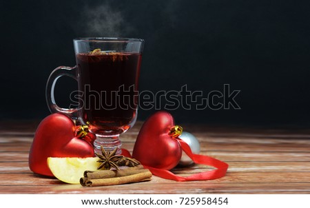 happy new year warming drink in a glass beaker red mulled wine with cinnamon