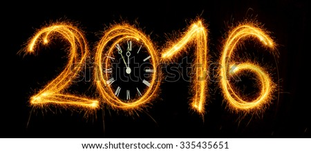 Happy New Year - 2016 with clock face made with sparklers on black background