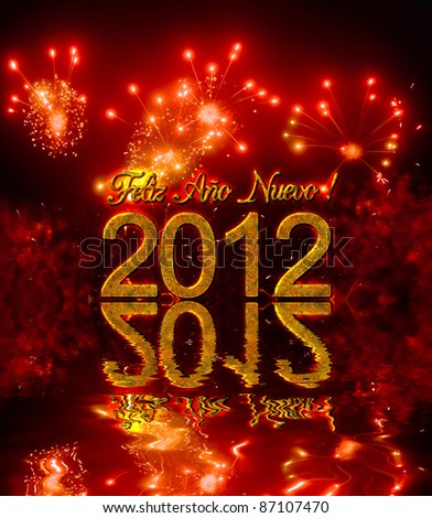 Happy new year 2012 with fireworks, congratulation in spanish - stock photo