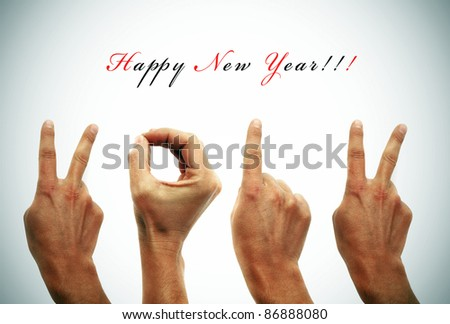 happy new year with hands forming number 2012 - stock photo