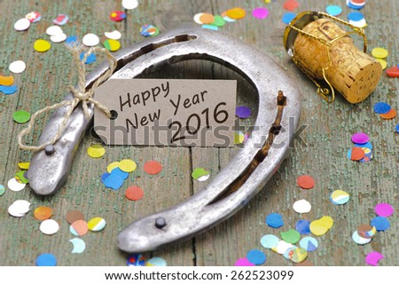 Happy new year 2016 with horse shoe as lucky charm - stock photo