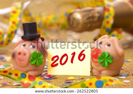 Happy new year 2016 with pig made with marzipan as lucky charm - stock photo