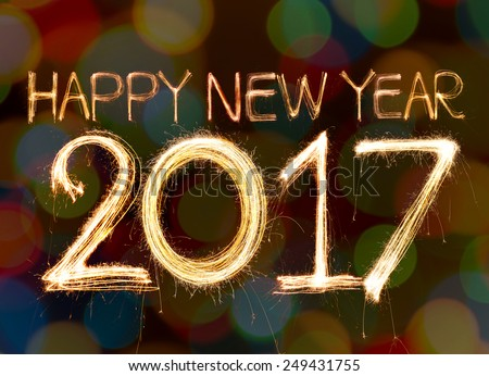 Happy new year 2017 word made from sparkler light firework on bokeh background
