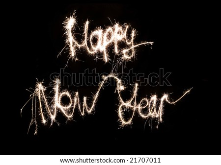Happy New Year words made by sparkler - stock photo
