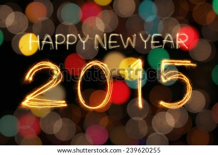 Happy New Year 2015 writing sparkle firework with dirty defocused colorful light blur background - stock photo