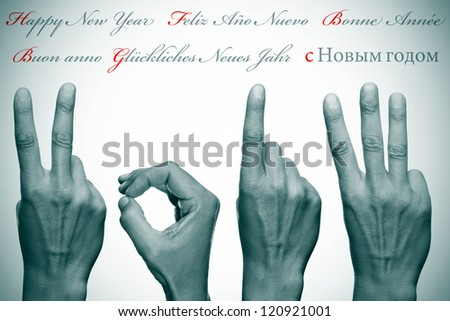 happy new year written in different languages with hands forming number 2013 - stock photo