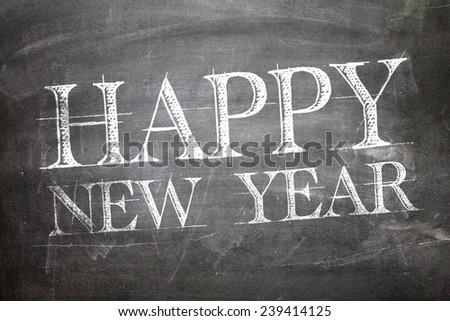 Happy New Year written on blackboard - stock photo
