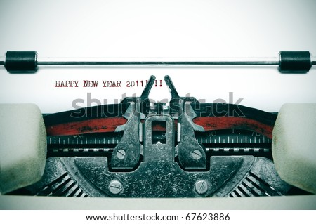 happy new year 2011 written with an old typewriter - stock photo