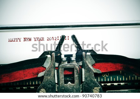 happy new year 2012 written with an old typewriter - stock photo
