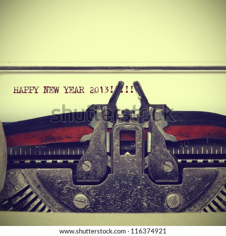 happy new year 2013 written with an old typewriter with a retro effect - stock photo