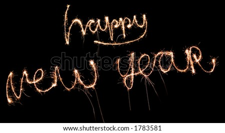 happy new year written with fireworks (sparkles) - stock photo